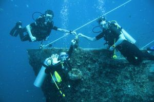 Scuba divers with BCD